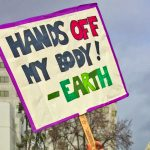 "Women's March Oakland sign ""Hands off my body!- Earth"""